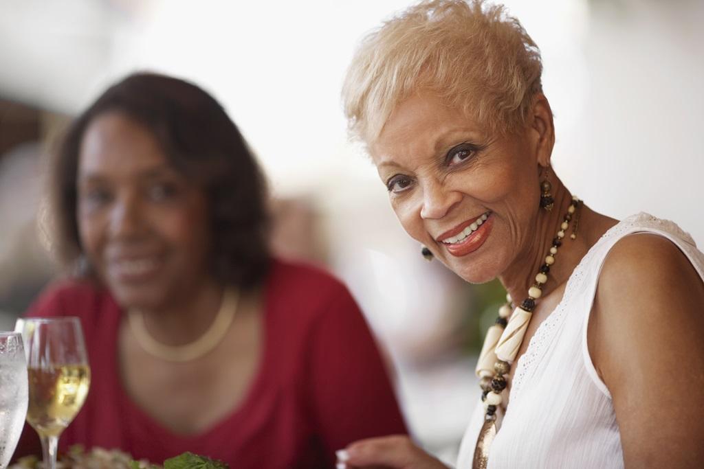 senior woman glancing at camera while dining