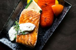 rectangular plate of grilled salmon and vegetables
