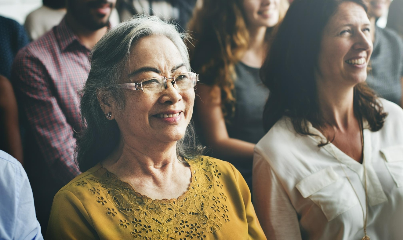 woman in audience at speaking engagement