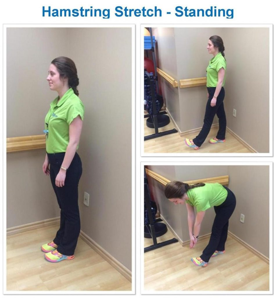 woman stretching her hamstrings while standing