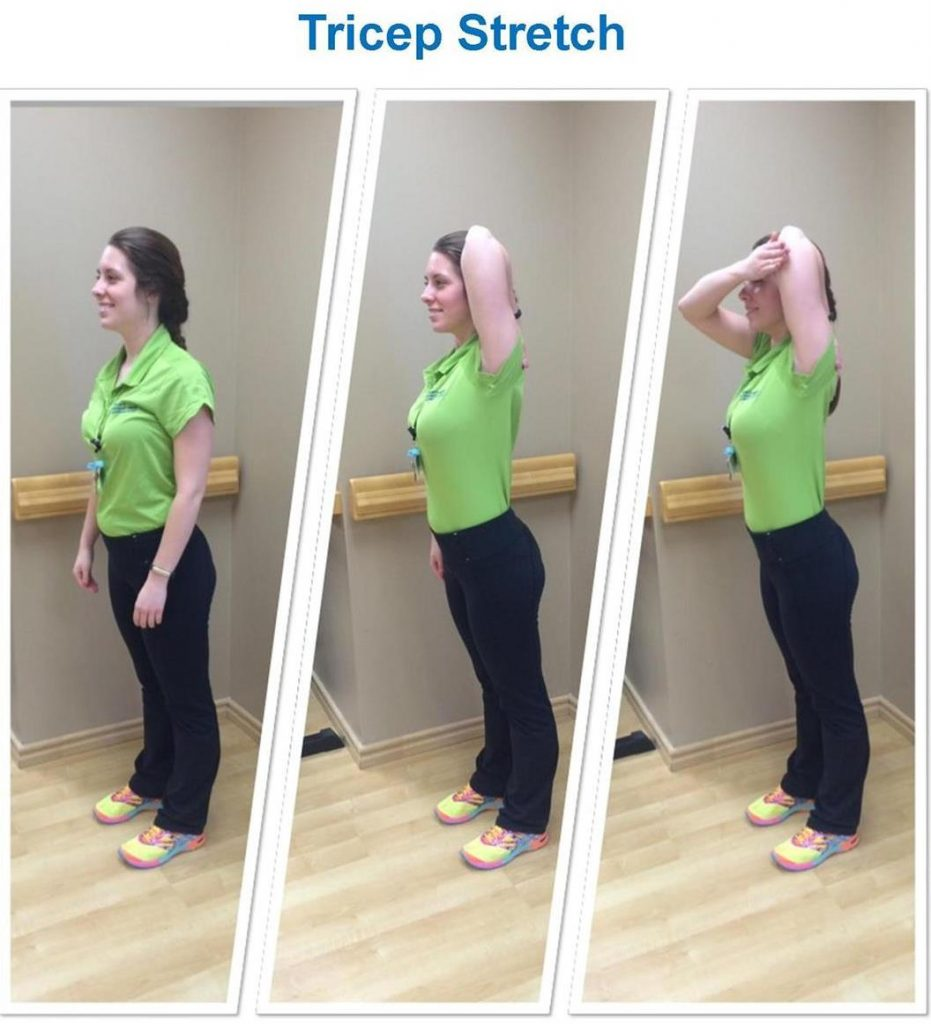 standing woman stretching her triceps