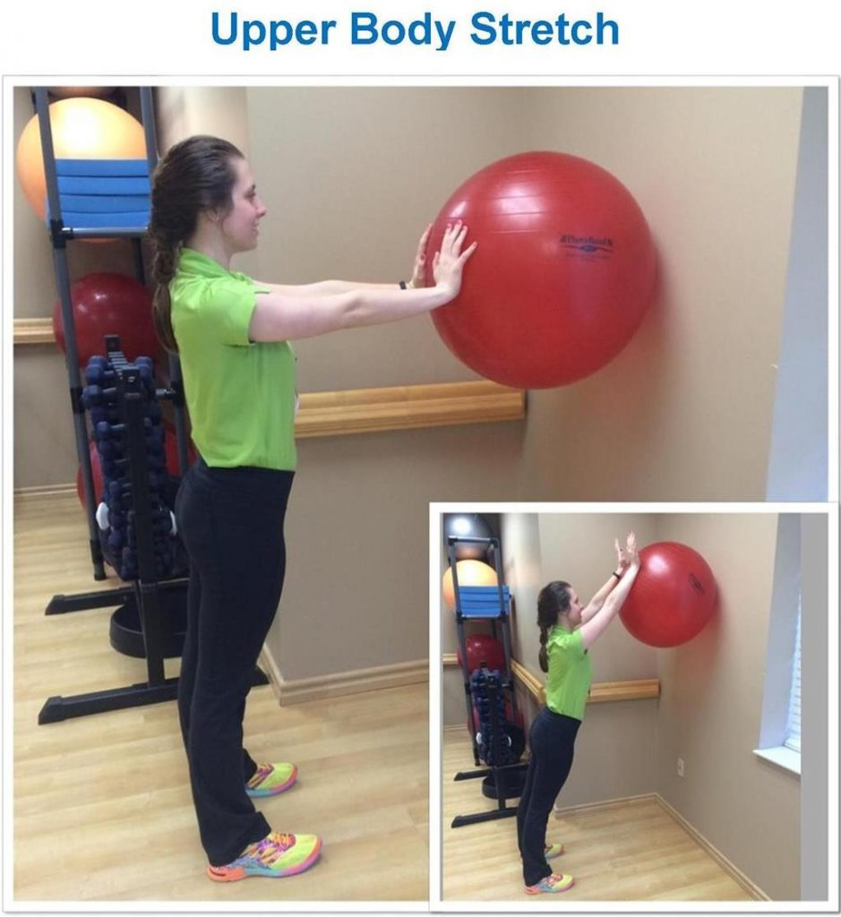woman using large ball to stretch her upper body