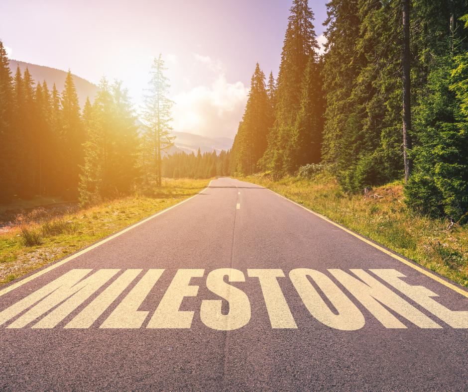 Milestone spelled in road